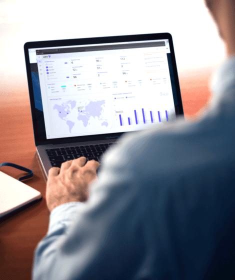 man looking at charts on a computer