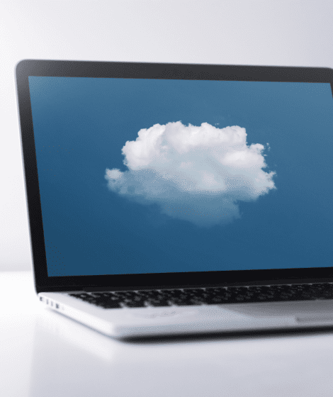 laptop with an image of a cloud on the screen